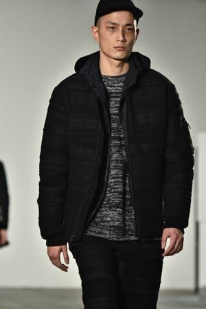 elliot: NEW YORK, NY - FEBRUARY 04: A model walks runway during the John Elliott + CO New York Fashion Week Mens FallWinter on February 4, 2016 in NYC.