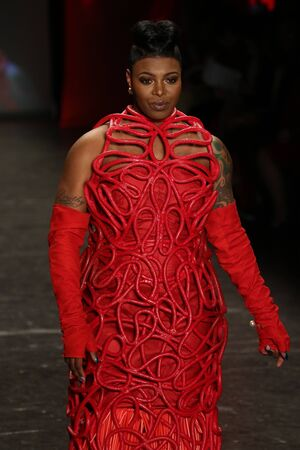 associations: NEW YORK, NY - FEBRUARY 11: Actress TaÂ'Rhonda Jones walks the runway at The American Heart Associations Go Red For Women Red Dress Collection 2016 Presented By Macys on February 11, 2016 in NYC.