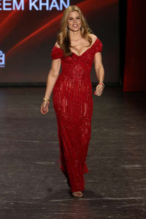 associations: NEW YORK, NY - FEBRUARY 11: Mary Alice Stephenson, wearing a limited edition, red leather Fitbit Alta(TM), walks the runway at The American Heart Associations Go Red For Women Red Dress Collection 2016 on February 11, 2016 in NYC.