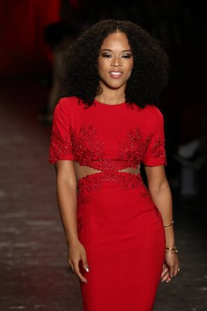 associations: NEW YORK, NY - FEBRUARY 11: Actress Serayah walks the runway at The American Heart Associations Go Red For Women Red Dress Collection 2016 Presented By Macys on February 11, 2016 in NYC. Editorial