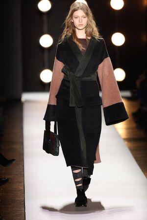 wristlet: NEW YORK, NY - FEBRUARY 11: A model walks the runway at the BCBGMAXAZRIA Fall 2016 fashion show during New York Fashion Week  on February 11, 2016 in NYC. Editorial