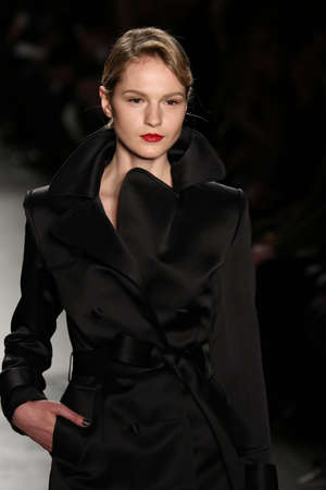 outwear: NEW YORK, CA - FEBRUARY 13: A model walks the runway at the Zang Toi Fall 2016 Fashion show during New York Fashion Week on February 13, 2016 in NYC.