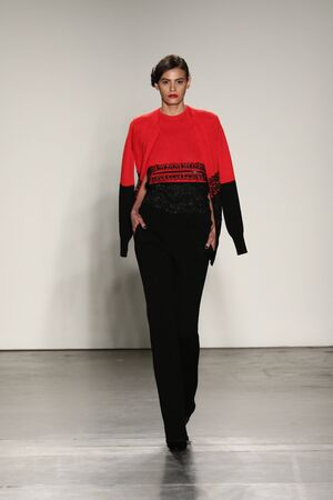 red cardigan: NEW YORK, CA - FEBRUARY 13: A model walks the runway at the Zang Toi Fall 2016 Fashion show during New York Fashion Week on February 13, 2016 in NYC.