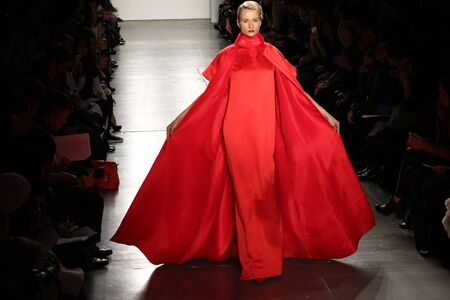 eveningwear: NEW YORK, CA - FEBRUARY 13: A model walks the runway at the Zang Toi Fall 2016 Fashion show during New York Fashion Week on February 13, 2016 in NYC.
