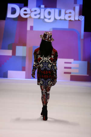 boater: NEW YORK, NY - FEBRUARY 11: A model walks the runway wearing Desigual Fall 2016 on February 11, 2016 in New York City.