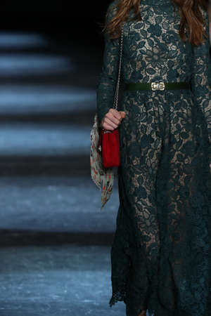 suede belt: NEW YORK, NY - FEBRUARY 13: A model walks the runway wearing Monique Lhuillier Fall 2016 on February 13, 2016 in NYC.