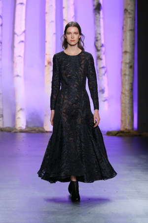 eveningwear: NEW YORK, NY - FEBRUARY 14: A model walks the runway wearing Noon By Noor Fall 2016 during New York Fashion Week on February 14, 2016 in NYC. Editorial