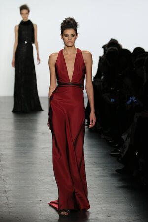 eveningwear: NEW YORK, NY - FEBRUARY 16: A model walks the runway at the Carmen Marc Valvo Runway show during Fall 2016 New York Fashion Week on February 16, 2016 in NYC. Editorial