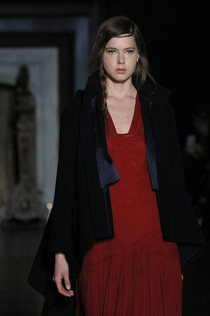 red cardigan: NEW YORK, NY - FEBRUARY 16: A model walks the runway at the Morgane Le Fay Fashion Show during Fall 2016 New York Fashion Week on February 16, 2016 in NYC.