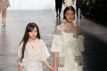 NEW YORK, NY - FEBRUARY 16: Designer Nhi Nguyen L and a model walk the runway at The Art Institutes Fall 2016 fashion show during New York Fashion Week on February 16, 2016 in NYC.