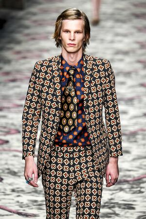 gucci: MILAN, ITALY - SEPTEMBER 23: A model walks the runway during the Gucci show as a part of Milan Fashion Week SpringSummer 2016 on September 23, 2015 in Milan, Italy.