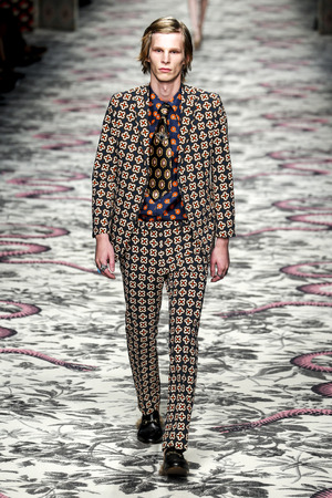 pantsuit: MILAN, ITALY - SEPTEMBER 23: A model walks the runway during the Gucci show as a part of Milan Fashion Week SpringSummer 2016 on September 23, 2015 in Milan, Italy.