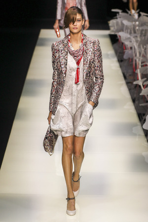 chagall: MILAN, ITALY - SEPTEMBER 28: A model walks the runway during the Giorgio Armani fashion show as part of Milan Fashion Week SpringSummer 2016 on September 28, 2015 in Milan, Italy.
