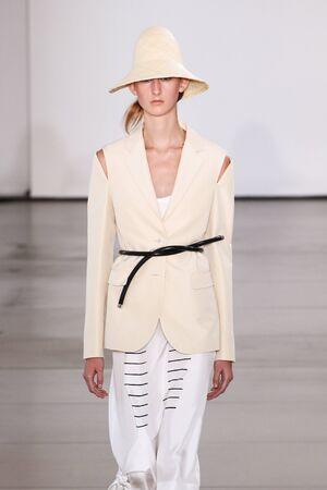 tailored: MILAN, ITALY - SEPTEMBER 26: A model walks the runway during the Jil Sander show as a part of Milan Fashion Week SpringSummer 2016 on September 26, 2015 in Milan, Italy.