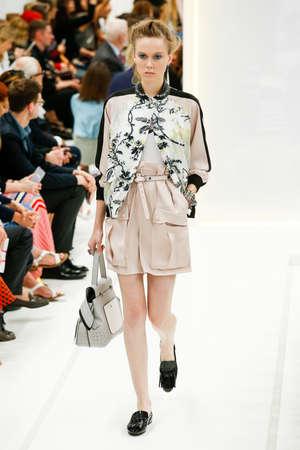 designer bag: MILAN, ITALY - SEPTEMBER 25: A model walks the runway during the Tods fashion show as part of Milan Fashion Week SpringSummer 2016 on September 25, 2015 in Milan, Italy. Editorial