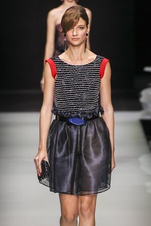 double breasted: MILAN, ITALY - SEPTEMBER 28: A model walks the runway during the Giorgio Armani fashion show as part of Milan Fashion Week SpringSummer 2016 on September 28, 2015 in Milan, Italy.