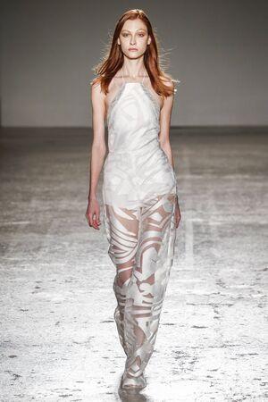 MILAN, ITALY - SEPTEMBER 23: A model walks the runway during the Genny show as a part of Milan Fashion Week SpringSummer 2016 on September 23, 2015 in Milan, Italy. Sajtókép