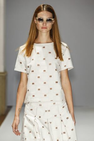 short sleeved: MILAN, ITALY - SEPTEMBER 23: A model walks the runway during the Chicca Lualdi fashion show as part of Milan Fashion Week SpringSummer 2016 on September 23, 2015 in Milan, Italy.
