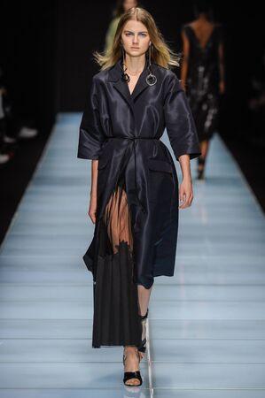 MILAN, ITALY - SEPTEMBER 24: A model walks the runway during the Anteprima fashion show as part of Milan Fashion Week SpringSummer 2016 on September 24, 2015 in Milan, Italy.