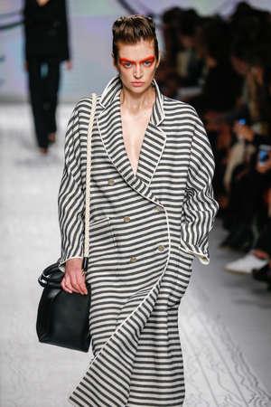 MILAN, ITALY - SEPTEMBER 24: A model walks the runway during the Max Mara show as a part of Milan Fashion Week SpringSummer 2016 on September 24, 2015 in Milan, Italy. Editorial