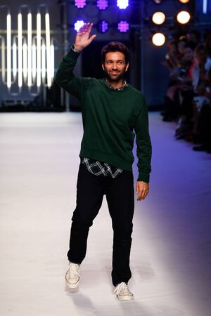 massimo: MILAN, ITALY - SEPTEMBER 27: Designer Massimo Giorgetti walks the runway during the MSGM fashion show as part of Milan Fashion Week SpringSummer 2016 on September 27, 2015 in Milan, Italy.