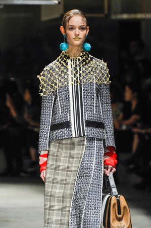 boxy: MILAN, ITALY - SEPTEMBER 24: A model walks the runway during the Prada fashion show as part of Milan Fashion Week SpringSummer 2016 on September 24, 2015 in Milan, Italy.