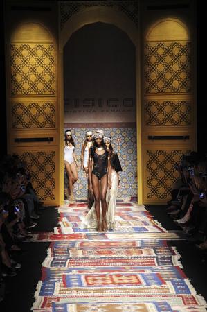 caftan: MILAN, ITALY - SEPTEMBER 25: A model walks the runway during the Fisico Christina Ferrari show as a part of Milan Fashion Week SpringSummer 2016 on September 25, 2015 in Milan, Italy. Editorial