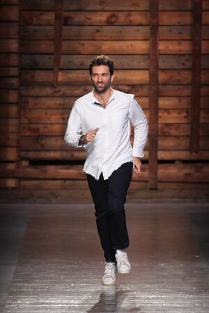 massimo: MILAN, ITALY - SEPTEMBER 24: Designer Massimo Giorgetti acknowledges the applause of the audience after the Emilio Pucci fashion show as part of Milan Fashion Week SpringSummer 2016 on September 24, 2015 in Milan, Italy.