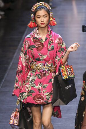 caftan: MILAN, ITALY - SEPTEMBER 27: A model walks the runway during the Dolce and Gabbana show as a part of Milan Fashion Week SpringSummer 2016 on September 27, 2015 in Milan, Italy.