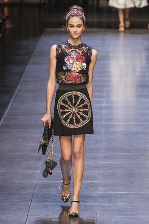 MILAN, ITALY - SEPTEMBER 27: A model walks the runway during the Dolce and Gabbana show as a part of Milan Fashion Week SpringSummer 2016 on September 27, 2015 in Milan, Italy.