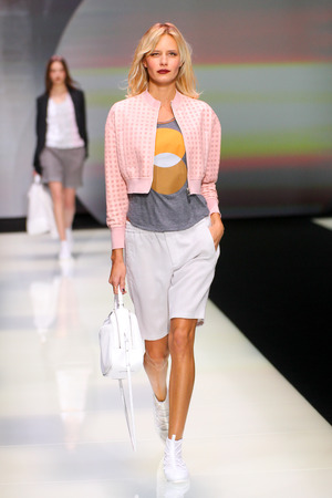 shorts t shirt sexy: MILAN, ITALY - SEPTEMBER 25: A model walks the runway during the Emporio Armani show as a part of Milan Fashion Week SpringSummer 2016 on September 25, 2015 in Milan, Italy.