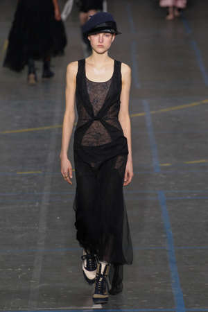 show bill: PARIS, FRANCE - MARCH 06: Model Kirin Dejonckheere walks the runway during the John Galliano show as part of the PFW FallWinter 201617 on March 6, 2016 in Paris, France.