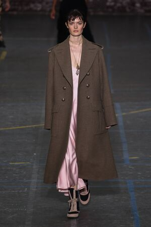 show bill: PARIS, FRANCE - MARCH 06: Model Sam Rollinson walks the runway during the John Galliano show as part of the PFW FallWinter 201617 on March 6, 2016 in Paris, France.