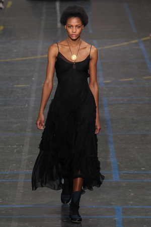 show bill: PARIS, FRANCE - MARCH 06: Model Karly Loyce walks the runway during the John Galliano show as part of the PFW FallWinter 201617 on March 6, 2016 in Paris, France.