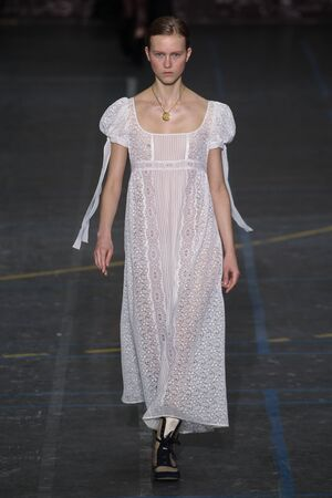 show bill: PARIS, FRANCE - MARCH 06: Model  Julie Hoomans walks the runway during the John Galliano show as part of the PFW FallWinter 201617 on March 6, 2016 in Paris, France.