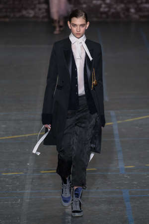 show bill: PARIS, FRANCE - MARCH 06: Model Yuliia Ratner walks the runway during the John Galliano show as part of the PFW FallWinter 201617 on March 6, 2016 in Paris, France. Editorial