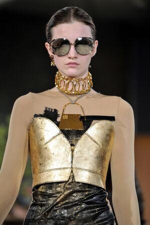 lvmh: PARIS, FRANCE - MARCH 4: Model Emma Harris walks runway at the Loewe show during Paris Fashion Week AutumnWinter 201617 on March 4, 2016 in Paris, France. Editorial