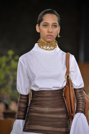 lvmh: PARIS, FRANCE - MARCH 4: Model Yasmin Wijnaldum walks runway at the Loewe show during Paris Fashion Week AutumnWinter 201617 on March 4, 2016 in Paris, France. Editorial