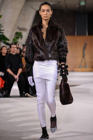 lvmh: PARIS, FRANCE - MARCH 4: Model Noemie Abigail walks runway at the Loewe show during Paris Fashion Week AutumnWinter 201617 on March 4, 2016 in Paris, France.