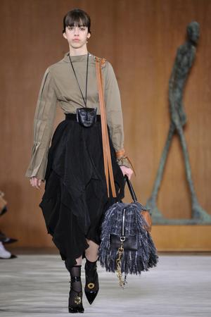 lvmh: PARIS, FRANCE - MARCH 4: Model Mayka Merino walks runway at the Loewe show during Paris Fashion Week AutumnWinter 201617 on March 4, 2016 in Paris, France. Editorial