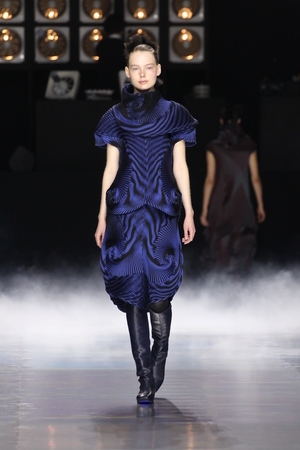 pleat: PARIS, FRANCE - MARCH 04: A model walks the runway during the Issey Miyake show as part of the Paris Fashion Week Womenswear FallWinter 20162017 on March 4, 2016 in Paris, France.