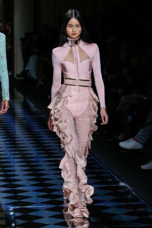 he: PARIS, FRANCE - MARCH 03: Cong He walks the runway during the Balmain show as part of the Paris Fashion Week Womenswear FallWinter 20162017 on March 3, 2016 in Paris, France.
