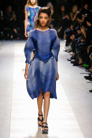 pleat: PARIS, FRANCE - OCTOBER 02: A model walks the runway during the Issey Miyake show as part of the Paris Fashion Week Womenswear SS 2016 on October 02, 2015 in Paris, France. Editorial