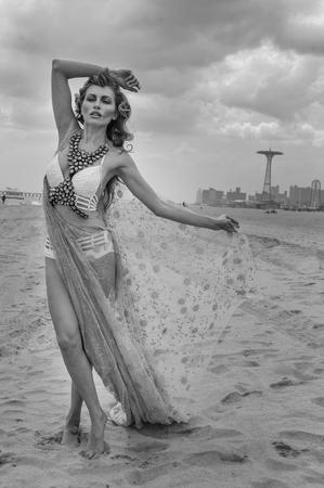 coney: Monochrome photos of model walking at empty beach on Coney Island, Brooklyn NY. Stock Photo