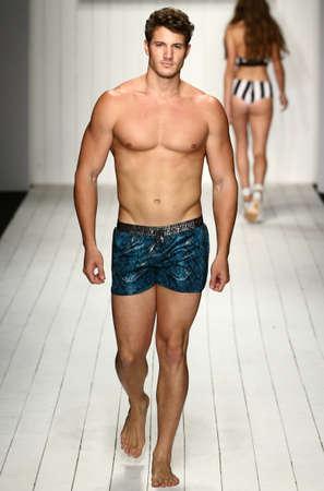 supermodel: MIAMI, FL - JULY 16: A model walks runway in designer swim apparel during the MisterTripleX fashion show for Miami Swim Week on July 16, 2015 Editorial