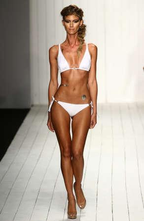 hottie: MIAMI, FL - JULY 16: A model walks runway in designer swim apparel during the Liliana Montoya fashion show for Miami Swim Week on July 16, 2015