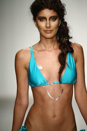 supermodel: MIAMI, FL - JULY 16: A model walks runway in designer swim apparel during the Liliana Montoya fashion show for Miami Swim Week on July 16, 2015