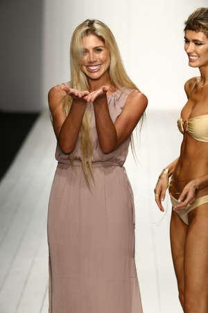 hottie: MIAMI, FL - JULY 16: Designer Liliana Montoya and model walks runway finale at the Liliana Montoya fashion show for Miami Swim Week on July 16, 2015