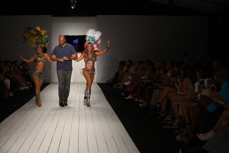 even: MIAMI, FL - JULY 16: Designer Gil Even walks runwaywith dancers at the CA-RIO-CA fashion show for Miami Swim Week on July 16, 2015MIAMI, FL - JULY 16: A model walks runway in designer swim apparel during the CA-RIO-CA fashion show for Miami Swim Week on J Editorial