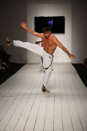 supermodel: MIAMI, FL - JULY 16: Dancers performs capoeira on the runway during the CA-RIO-CA fashion show for Miami Swim Week on July 16, 2015